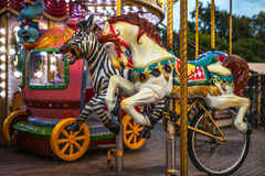 PARIS, FRANCE - AUGUST 30, 2015: Old French carousel in a holiday park at night summer time. Royalty Free Stock Photo