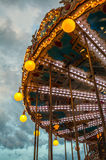 PARIS, FRANCE - AUGUST 30, 2015: Old French carousel in a holiday park at night summer time. Stock Photography