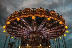 PARIS, FRANCE - AUGUST 30, 2015: Old French carousel in a holiday park at night summer time. PARIS, FRANCE - AUGUST 30, 2015: Old French carousel in a holiday royalty free stock image