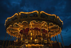 PARIS, FRANCE - AUGUST 30, 2015: Old French carousel in a holiday park at night summer time. PARIS, FRANCE - AUGUST 30, 2015: Old French carousel in a holiday stock image