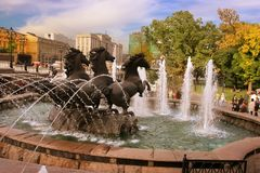 MOSCOW, RUSSIA - September 18, 2017: Fountain Four seasons at the Manege square in Moscow. Cityscape of Manezhnaya square in city. Center of Moscow, Russia stock photography