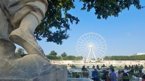 Paris, France. August 30th 2016. Les Tuileries park with the Roue de Paris (Big Wheel of Paris) under a sunny sky Royalty Free Stock Photos