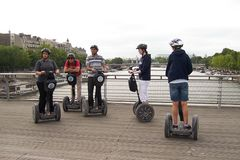 Paris, France-August 07, 2009: Tourists of different nationalities explore the sights of Paris on Segways royalty free stock photo