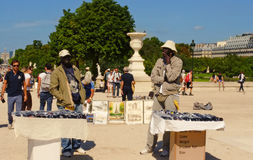 PARIS, FRANCE - August 19, 2014. Two sellers sell souvenirs souv Stock Photography