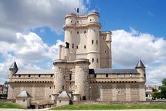 Paris, France: Château de Vincennes. The imposing feudal keep tower, barbican, enclosed ramparts, and corner turrets of Le Château de Vicennes in Paris, France Stock Images