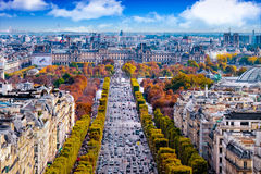 Paris, France - Champs Elysees cityscape. View from Arc de Triomphe. Dramatic sunset sky with clouds in autumn royalty free stock images