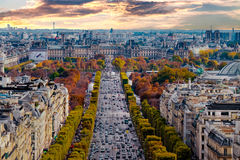 Paris, France - Champs Elysees cityscape. View from Arc de Triomphe. Dramatic sunset sky with clouds in autumn royalty free stock photos