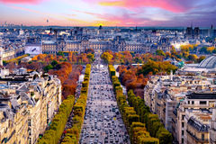 Paris, France - Champs Elysees cityscape. View from Arc de Triomphe. Dramatic sunset sky with clouds in autumn royalty free stock photo