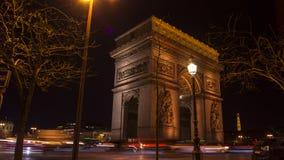 Paris,France: Champs Elysees and Triumphal Arch illuminated for Christmas. Paris,France: Champs Elysees and Triumphal Arch with traffic cars in the dusk stock photos