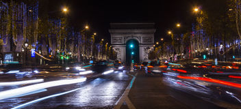 Paris,France: Champs Elysees and Triumphal Arch illuminated for Christmas. Paris,France: Champs Elysees and Triumphal Arch with traffic cars in the dusk Stock Image