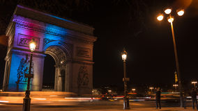 Paris,France: Champs Elysees and Triumphal Arch illuminated for Christmas. Paris,France: Champs Elysees and Triumphal Arch with traffic cars in the dusk Stock Photos