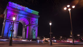 Paris,France: Champs Elysees and Triumphal Arch illuminated for Christmas. Paris,France: Champs Elysees and Triumphal Arch with traffic cars in the dusk Royalty Free Stock Image