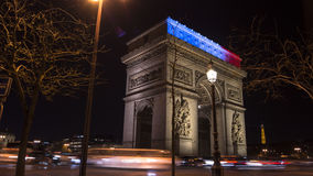 Paris,France: Champs Elysees and Triumphal Arch illuminated for Christmas. Paris,France: Champs Elysees and Triumphal Arch with traffic cars in the dusk Royalty Free Stock Images