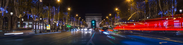 Paris,France: Champs Elysees and Triumphal Arch illuminated for Christmas. Paris,France: Champs Elysees and Triumphal Arch with traffic cars in the dusk Stock Images