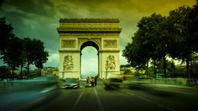 Paris,France: Champs Elysees and Triumphal Arch with traffic cars Royalty Free Stock Photos
