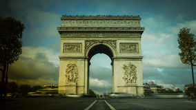 Paris,France: Champs Elysees and Triumphal Arch with traffic cars. In the dusk Stock Image