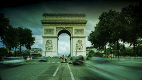 Paris,France: Champs Elysees and Triumphal Arch with traffic cars. In the dusk stock images