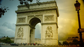 Paris,France: Champs Elysees and Triumphal Arch with traffic cars. In the dusk Royalty Free Stock Photography