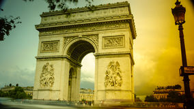 Paris,France: Champs Elysees and Triumphal Arch with traffic cars. In the dusk Royalty Free Stock Photo