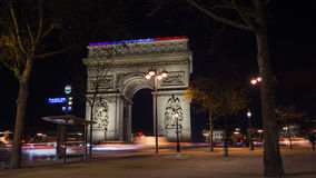 Paris,France: Champs Elysees and Triumphal Arch with traffic cars. In the dusk royalty free stock image