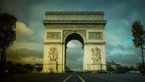 Paris,France: Champs Elysees and Triumphal Arch with traffic cars. In the dusk royalty free stock photos