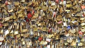 PARIS, FRANCE- CIRCA August 2017: Bridge fence full of locks. Lovers Romantic Bridge in Paris.  stock footage