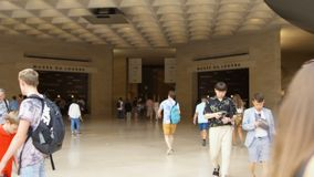 PARIS, FRANCE- CIRCA August 2017: Inside view of famous Louvre museum. People walking by. PARIS, FRANCE- CIRCA August 2017: Inside view of famous Louvre museum stock video footage