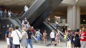 Paris, France- Circa August 2017: Inside view of famous Louvre museum. People walking by, escalators. Paris, France- Circa August 2017: Inside view of famous stock video footage