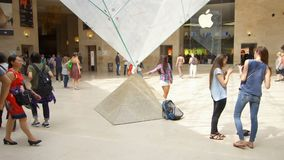 PARIS, FRANCE- CIRCA August 2017: Louvre museum. Inside view of famous Louvre pyramid, people walking by. PARIS, FRANCE- CIRCA August 2017: Louvre museum. Inside stock video footage