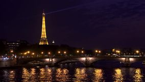 Paris, France - circa August 2017: Searchlight on top of famous french landmark Eiffel Tower at night. Paris, France - circa August 2017: Eiffel Tower at night stock video