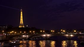 Paris, France- circa August 2017: Searchlight on top of famous french landmark Eiffel Tower at night. Paris, France- circa august 2017: Eiffel Tower at night stock video