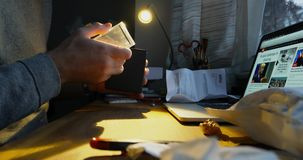 Man unboxing unpacking the Braun clock. PARIS, FRANCE - CIRCA 2017: Curious man unboxing unpacking the postage envelope containing the Braun Luxury designer stock video