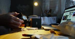 Man unboxing unpacking the Braun clock. PARIS, FRANCE - CIRCA 2017: Curious man unboxing unpacking the postage envelope containing the Braun Luxury designer stock video footage