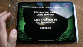 Apple Computers website featuring Arcade video game subscription service. Paris, France - Circa 2019: Man POV at the new iPad Pro with Apple.com website stock footage