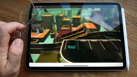 Apple Computers website featuring Arcade video game subscription service. Paris, France - Circa 2019: Man POV at the new iPad Pro with Apple.com website watching stock video footage