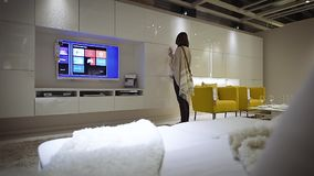 Woman shopping furniture in IKEA modern store. PARIS, FRANCE - CIRCA 2018: Modern IKEA furniture store woman customer browsing through diverse furniture stock video