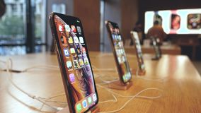 New Apple iPhone XS smartphones diverse colors and sizes stock video footage