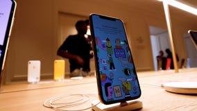 Pan over new luxury iPhone 11 Pro smartphone in Apple Store
