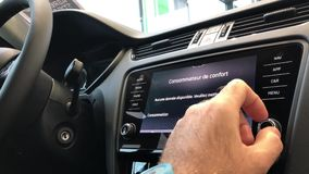 Man using car electronic display. PARIS, FRANCE - CIRCA 2017: Point of view of man using the new navigation dashboard touchscreen of a Skoda Volkswagen car - DAB stock video