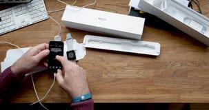 Unpairing Man unboxing new Apple Watch wearable smartwatch computer. PARIS, FRANCE - CIRCA 2018: POV man unboxing unpacking latest Apple Watch Series 3 GPS LTE stock footage
