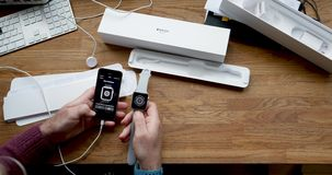 Man unboxing new Apple Watch wearable smartwatch computer. PARIS, FRANCE - CIRCA 2018: POV man unboxing unpacking latest Apple Watch Series 3 GPS LTE smartwatch stock video