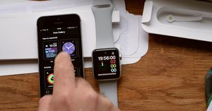 Man unboxing new Apple Watch wearable smartwatch computer. PARIS, FRANCE - CIRCA 2018: POV man unboxing unpacking latest Apple Watch Series 3 GPS LTE smartwatch stock footage