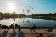 PARIS, FRANCE - circa spring 2018: Roue de Paris panorama. PARIS, FRANCE - circa spring 2018: Eye of Paris panorama reflected in a fountain reflection roue de stock photography