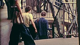 Eiffel Tower observation deck. PARIS, FRANCE - CIRCA 1976: Tourists in 70s dress, descending from the observation deck of Paris from Eiffel Tower. Historic stock video