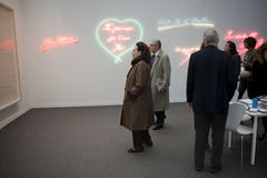 Paris, France, Contemporary Art Exhibit, FIAC,. People Looking at Neon Light Sculpture, by Tracey Emin, More Passion, 2010 Royalty Free Stock Photo