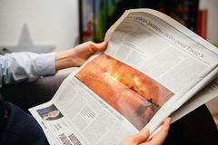 Woman reading french le figaro newspaper editorial stock image