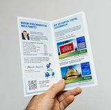 Man holding PayBack leaflet flyer Stock Image