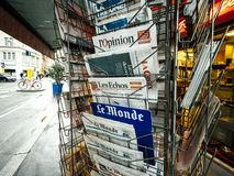 French newspaper kiosk selling. PARIS, FRANCE - DEC 10, 2018: Newspaper stand kiosk stand selling press with multiple French newspapers, l`Opinion, Express, Le stock photography
