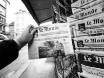 French newspaper kiosk selling man buy Le Monde stock photo