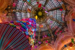 Galeries Lafayette, Paris. Paris, France - December 31, 2017: Abundantly decorated with Christmas tree and balloons main hall of famous luxurious department Stock Image
